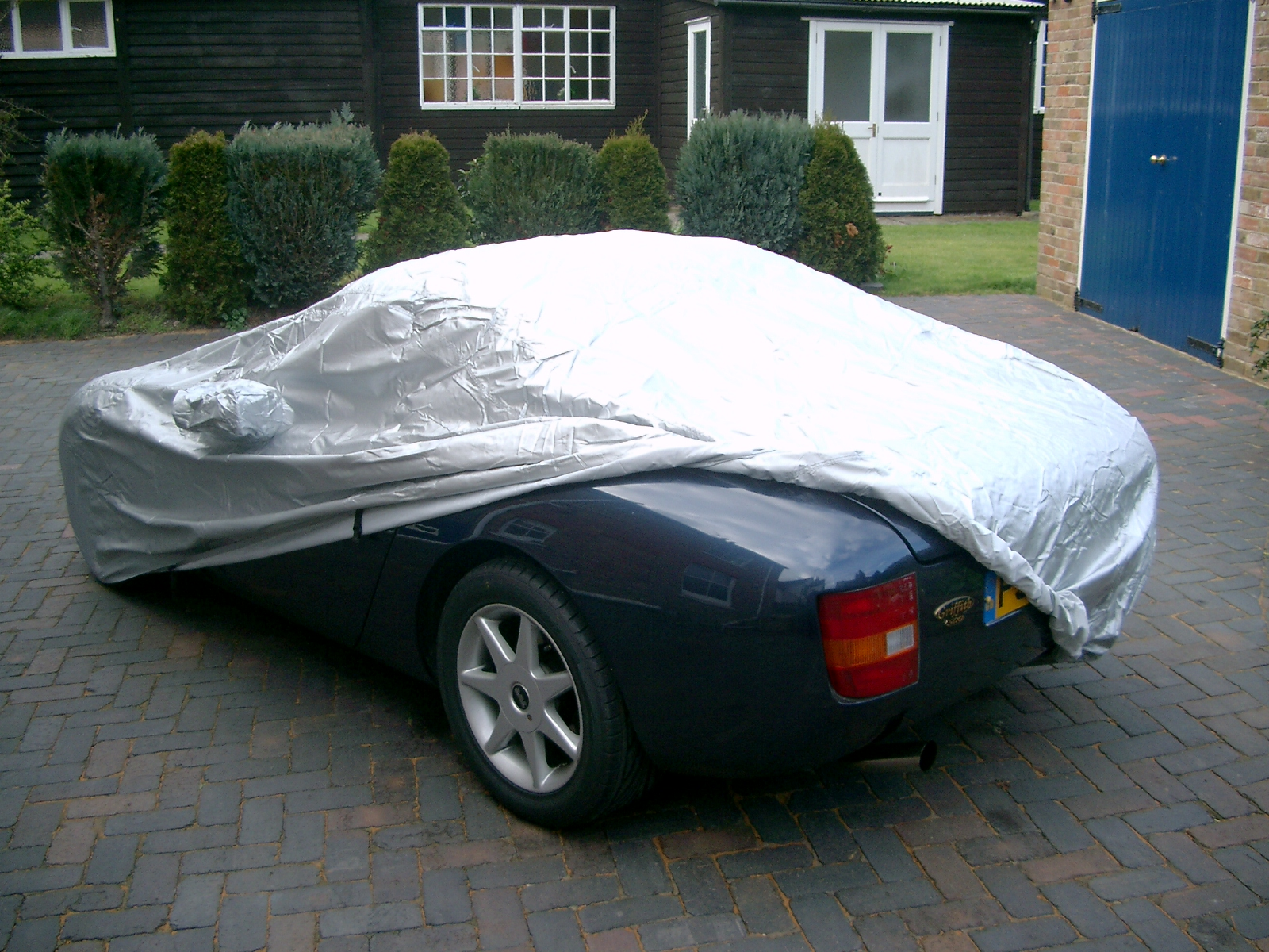 How can a car cover protect your car from the weather