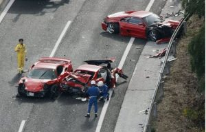 car accident with eight ferraris, one lamborghini, three mercedes, nissan, and a toyota prius
