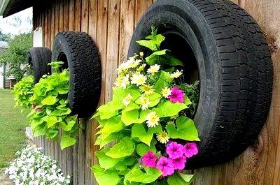 Flowers In Tire Garden Planters