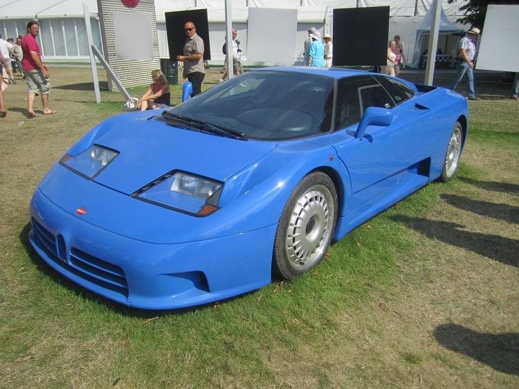 Blue Bugatti EB110 parked on grass