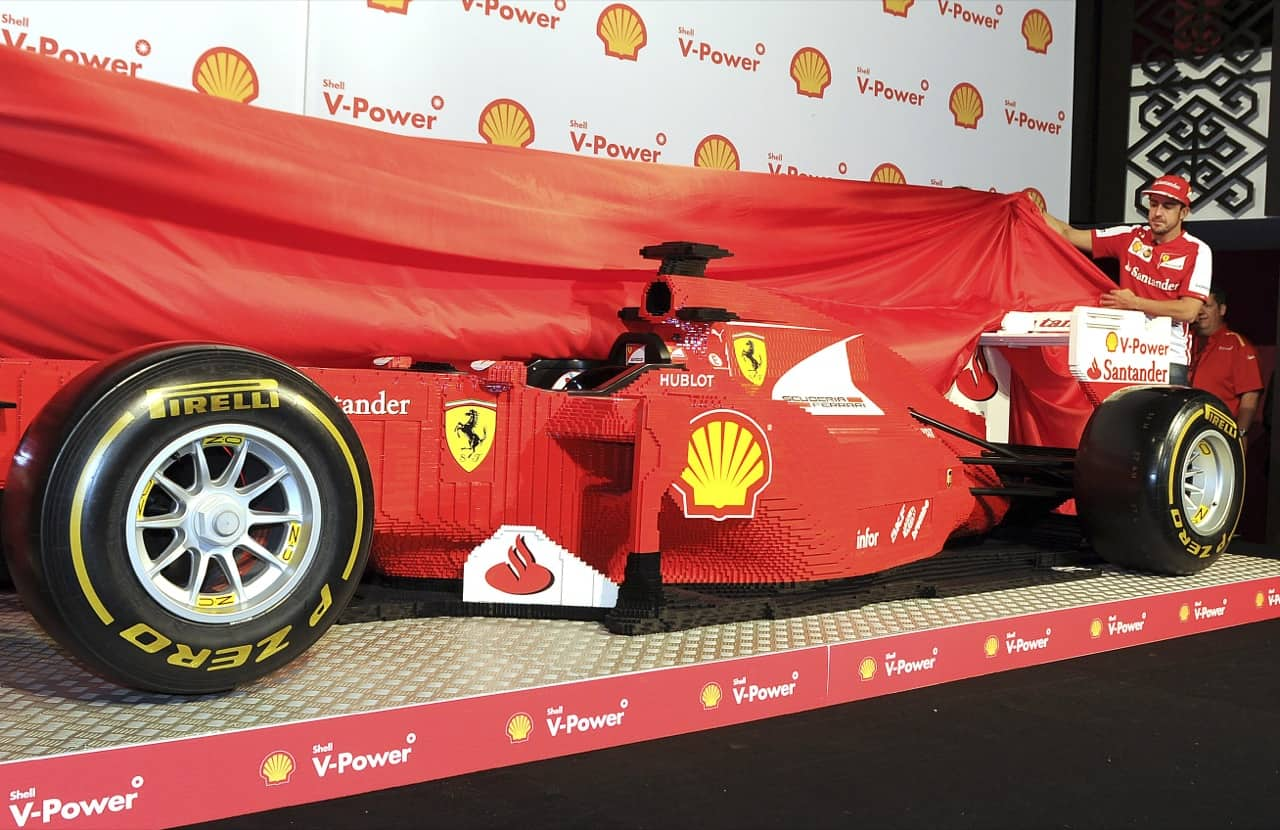 Ferrari driver Fernando Alonso of Spain right, and team mate Felipe Massa of Brazil (unseen)unveil a life size model of a F1GP car made out of Lego in Melbourne, Australia, Thursday, March 14, 2013 ahead of the Australian Formula One Grand Prix at Albert Park .(AP Photo/Andrew Brownbill)