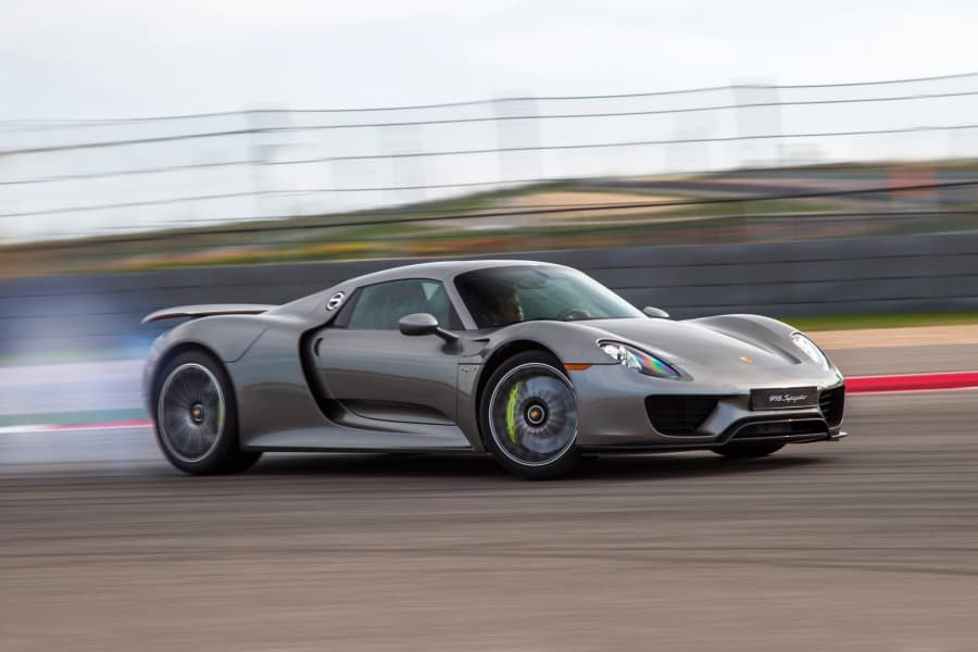 2015-porsche-918-spyder-front-three-quarter-in-motion-03