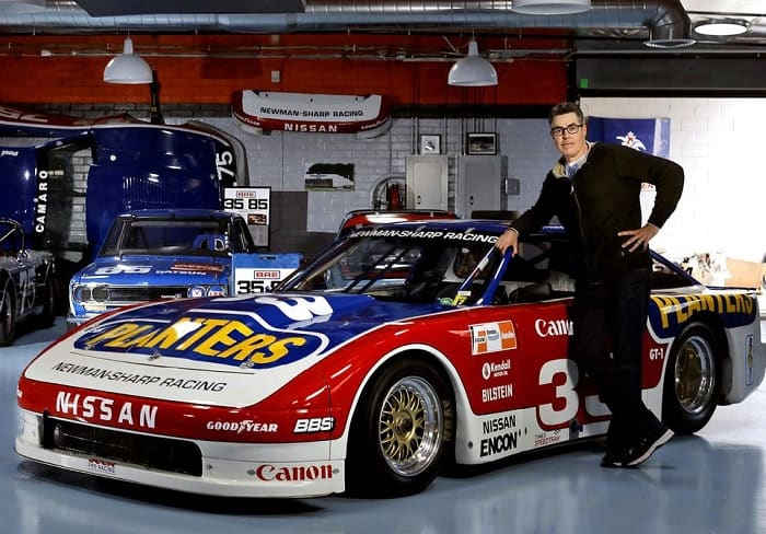 Adam Carolla with Paul Newman car