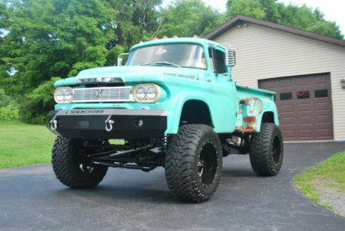 There are few Dodge W100 jacked up trucks