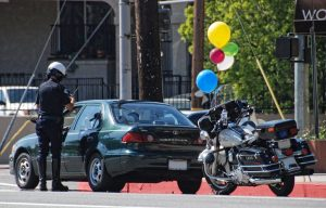 Cop sites driver with balloons