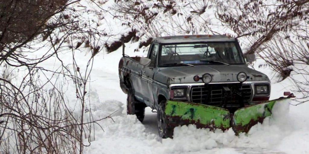 A Road Maintenance Vehicle With A Snow Plow