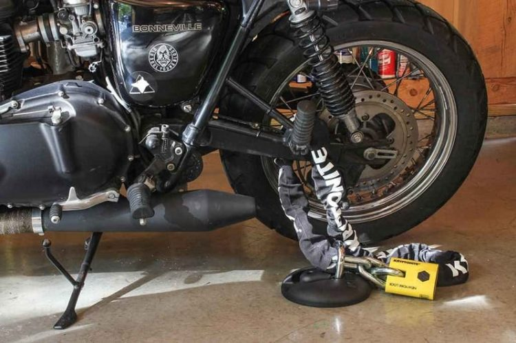 Motorcycle Locked With A Chain On The Swingarm