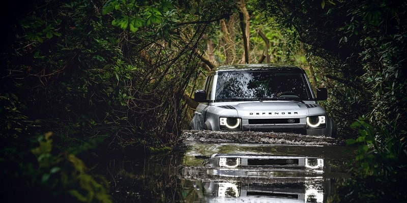 Land Rover Defender Wading Through Water