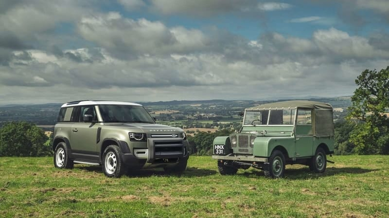 Modern and classic Defender side by side