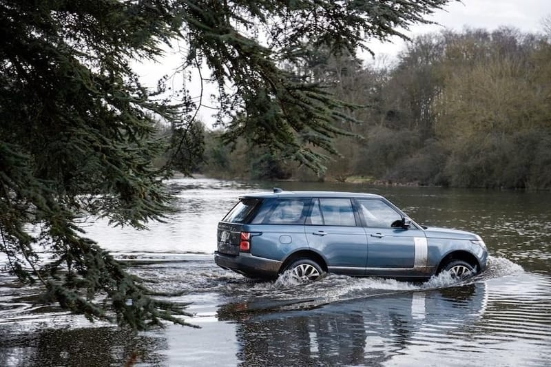 Land Rover Range Rover plug-in hybrid wading through water