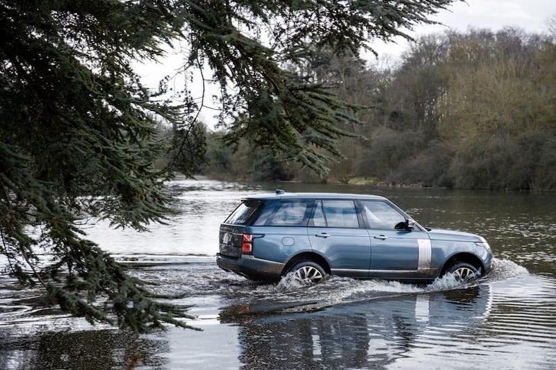 Land Rover Range Rover plug-in hybrid wading through water