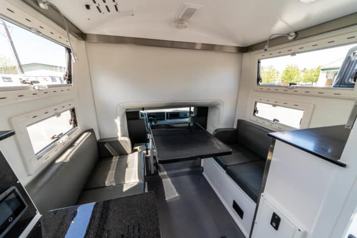 EarthCruiser FX cab interior contains lots of storage