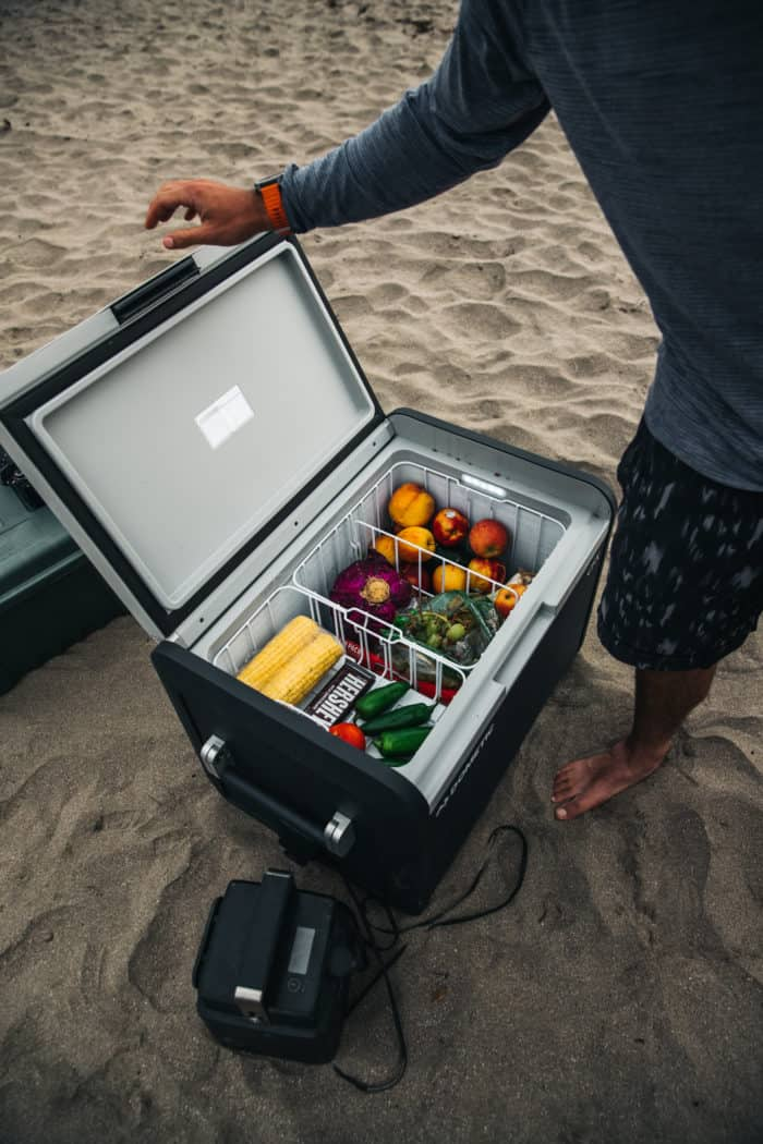 Dometic CFX3 55IM open on beach powered by Dometic PLB