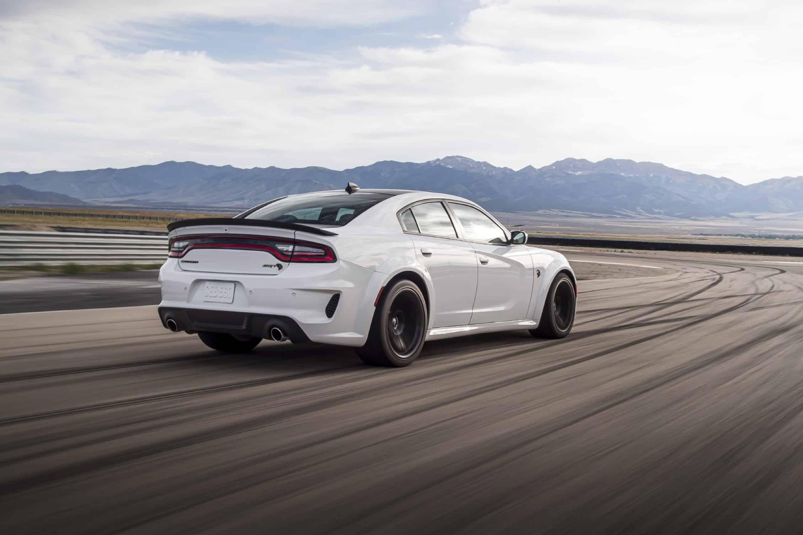 2021 Dodge Charger SRT Hellcat Redeye rear three quarter view in motion