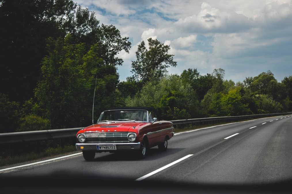 Driving Classic Ford convertible Car on highway